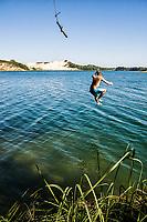 Young man jumping in the Arroio Corrente Lagoon. Jaguaruna, Santa Catarina, Brazil. / <br /> Homem jovem pulando na Lagoa do Arroio Corrente. Jaguaruna, Santa Catarina, Brasil.
