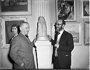 26/04/1958<br /> 04/26/1958<br /> 26 April 1958<br /> Varnishing Day at the R.H.A. Exhibition at the College of Art, Kildare Street, Dublin. Image shows Mr Maurice McGonigal, artist, RHA, and Mr. Marshall C. Hutson, (right) Sunday's Well, Cork, sculptor.