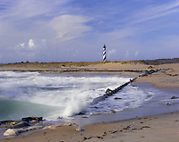 AA05842-01...NORTH CAROLINA - Waves hitting the jetty near Cape Hatteras Lighthouse in Cape Hatteras National Seashore on the Outer Banks.