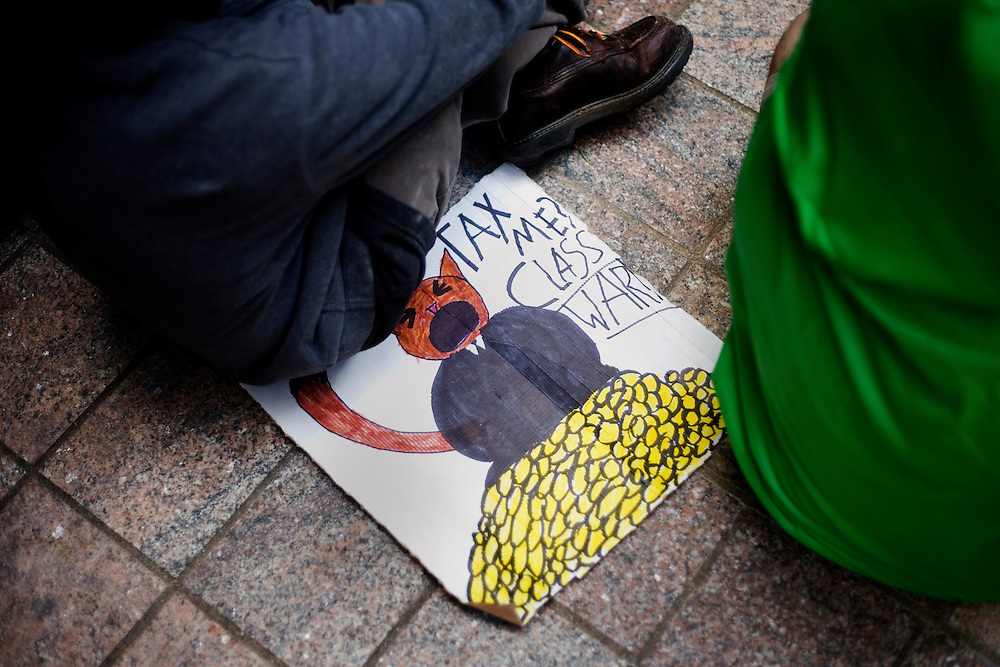 Protesters signs lay on the ground during the OccupyBoston demonstration in Dewey Square in the Financial District of downtown Boston, Massachusetts, USA. The protesters are part of  OccupyBoston, which is part of the OccupyWallStreet movement, expressing discontent with the socioeconomic situation of the 99% of the US population who are not wealthy.  Protestors have been camping in Dewey Square since Sept. 30, 2011. Gradually, larger organizations, including major labor unions, have expressed their support for the OccupyBoston effort.  On this day, Oct. 5, members of National Nurses United, the largest nurses' union in the US, marched alongside the OccupyBoston protesters.