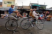 A ciclo driver waits for clients at eh market in Chau Doc, Vietnam.