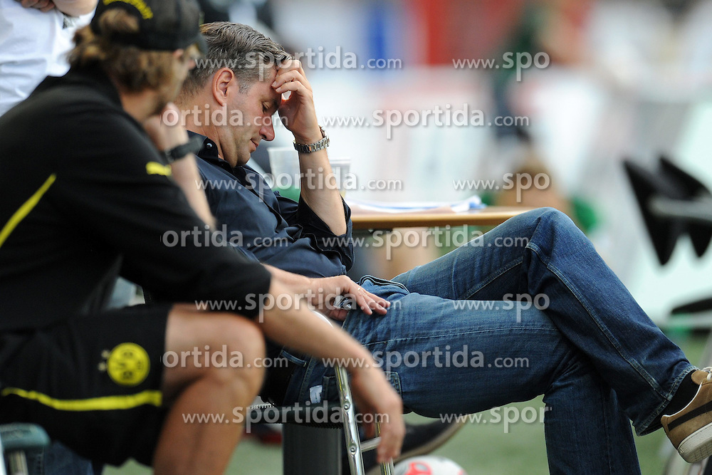 01.08.2012, Preussenstadion, Muenster, GER, Testspiel, SC Preussen Muenster vs Borussia Dortmund, im Bild Sportdirektor Michael Zorc (Dortmund) nachdenklich // during Friendly Match between SC Preussen Muenster and Borussia Dortmund at the Preussenstadium, Muenster, Germany on 2012/08/01. EXPA Pictures © 2012, PhotoCredit: EXPA/ Eibner/ Titgemeyer      ATTENTION - OUT OF GER *****