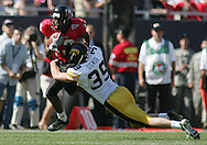 01 SEPTEMBER 2007: Iowa kicker Austin Signor (39) pulls down Northern Illinois kick returner Evans Adonis (13) in Iowa's 16-3 win over Northern Illinois at Soldiers Field in Chicago, Illinois on September 1, 2007.