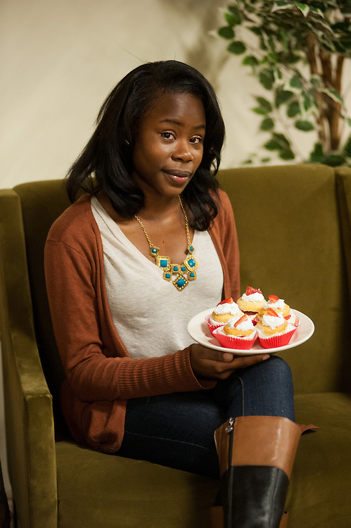 Karris Barclay, owner of Krave It! Cupcakes, holds up a batch of her homemade Strawberry Shortcake cupcakes outside the Voigt Hall communal kitchen Wednesday, February 13, 2013. Barclay, a freshman from Akron majoring in Special Education, began baking as a stress-reliever in high school.