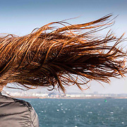 A young woman's hair is blown parallel to the sea on the ferry crossing from Brodick to Ardrossan during high winds. Picture Robert Perry 13th Feb 2017<br /> <br /> Must credit photo to Robert Perry<br /> FEE PAYABLE FOR REPRO USE<br /> FEE PAYABLE FOR ALL INTERNET USE<br /> www.robertperry.co.uk<br /> NB -This image is not to be distributed without the prior consent of the copyright holder.<br /> in using this image you agree to abide by terms and conditions as stated in this caption.<br /> All monies payable to Robert Perry<br /> <br /> (PLEASE DO NOT REMOVE THIS CAPTION)<br /> This image is intended for Editorial use (e.g. news). Any commercial or promotional use requires additional clearance. <br /> Copyright 2014 All rights protected.<br /> first use only<br /> contact details<br /> Robert Perry     <br /> 07702 631 477<br /> robertperryphotos@gmail.com<br /> no internet usage without prior consent.         <br /> Robert Perry reserves the right to pursue unauthorised use of this image . If you violate my intellectual property you may be liable for  damages, loss of income, and profits you derive from the use of this image.