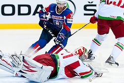 Andrei Mezin of Belarus covers a puck during ice-hockey match between Slovenia and Belarus of Group G in Relegation Round of IIHF 2011 World Championship Slovakia, on May 8, 2011 in Orange Arena, Bratislava, Slovakia. (Photo by Matic Klansek Velej / Sportida)