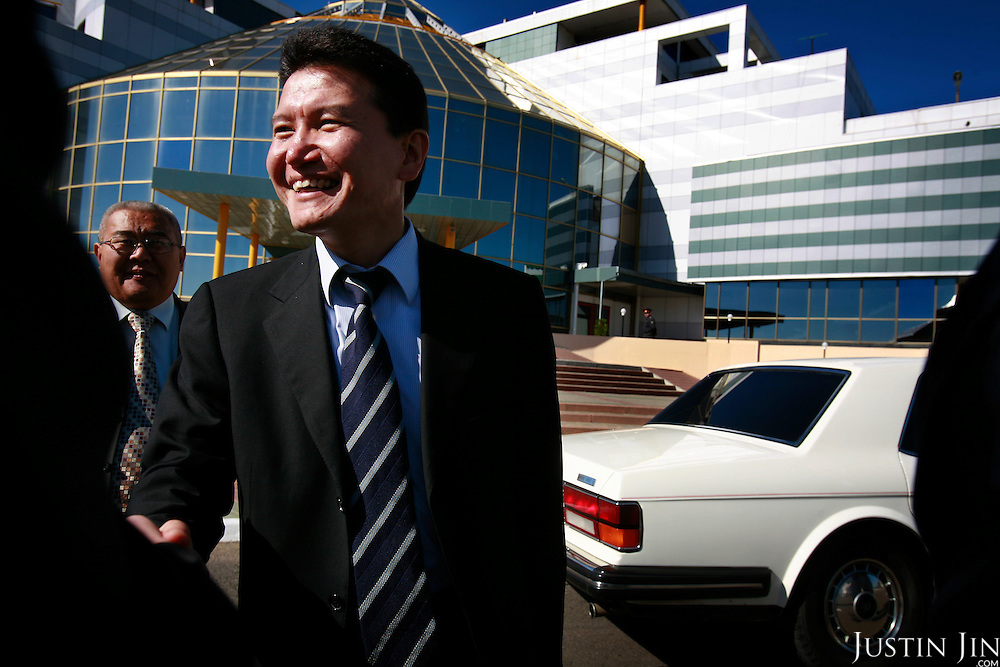 Kirsan Ilyumzhinov, 44, president of the southern Russian republic Kalmykia, stands in front of the Chess City in the provincial capital, Elista...Behind him is his assistant and white Rolls-Royce...Ilyumzhinov, who is also the president of the World Chess Federation, Fide, is hosting one of the world?s most important matches in history. ..The match beginning September 21 in Elista, the capital of Europe?s only Buddhist nation, will end a 13-year split in the game that has produced rival claims to the title. ..Veselin Topalov, a Bulgarian ranked first according to Fide, will play against Vladimir Kramnik, who is the Classical Chess World Champion, a title established after Garry Kasparov led a breakaway from Fide in 1993. The two grandmasters, both aged 31, will face each other for the right to be undisputed world chess champion...A Buddhist millionaire businessman, Ilyumzhinov acquired his wealth in the economic free-for-all which followed the collapse of the Soviet Union. ..At the age of just over 30, he was elected president in 1993 after promising voters $100 each and a mobile phone for every shepherd. Soon after, he introduced presidential rule, concentrating power in his own hands. ..He denies persistent accusations of corruption, human rights abuses and the suppression of media freedom. When Larisa Yudina, editor of the republic's only opposition newspaper and one of his harshest critics, was murdered in 1998, he strenuously rejected allegations of involvement. ..Mr Ilyumzhinov has been president of the International Chess Federation (FIDE) since 1995 and has been enthusiastic about attracting international tournaments to Kalmykia. His extravagant Chess City has led to protests by its impoverished citizens. .