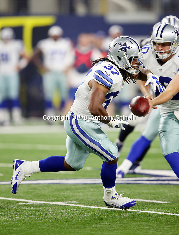 Dallas Cowboys running back Gus Johnson (37) runs the ball during the 2015 NFL preseason football game against the Houston Texans on Thursday, Sept. 3, 2015 in Arlington, Texas. The Cowboys won the game 21-14. (©Paul Anthony Spinelli)