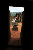 A tourist photographing the ancient Hindu temples of My Son Sanctuary, Vietnam