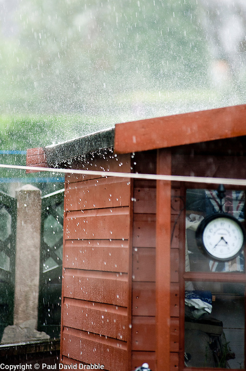 16:36 Ecclesfield Sheffield UK.A sudden Torrential summer downpour starts..5 July 2012.Image © Paul David Drabble