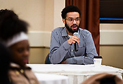 """Savion Castro responded to a question on the panel called """"Creating Impact and Staying Engaged While in College"""" during the Black Excellence Youth Conference at the Best Western Plus Inntowner on Monday, Jan. 15, 2018."""