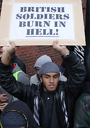 "© under license to London News Pictures. 13/12/2010 Two suspected members of Muslims Against Crusades have been charged after allegedly burning poppies on Armistice Day, 11/11/2010. Abu Ubaidah holds a placard stating ""British soldiers burn in hell!"" at the protest"