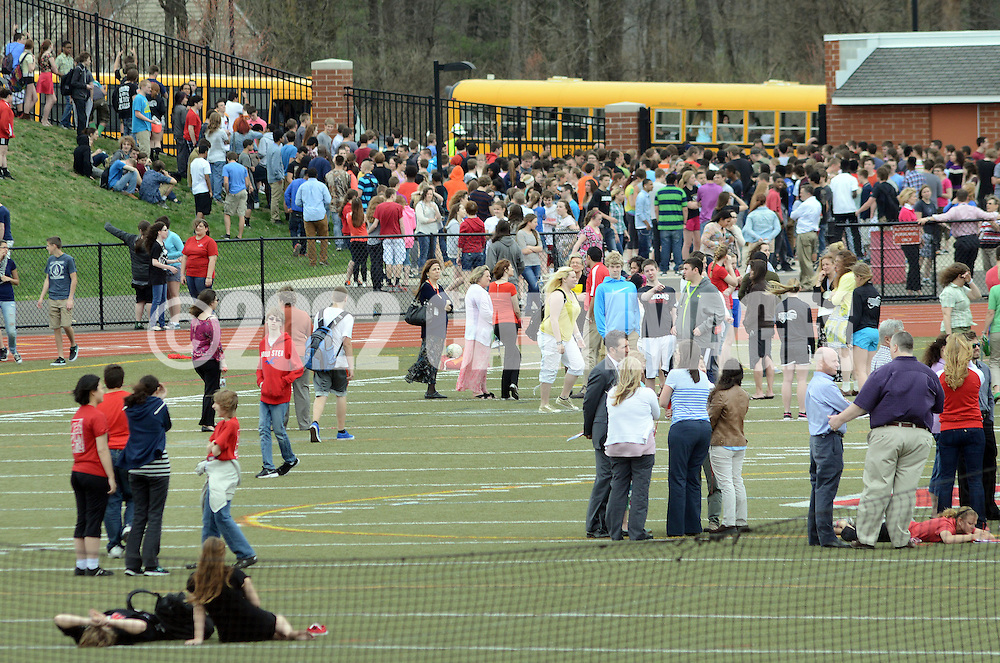 SOUDERTON, PA - APRIL 14:  Students waits on the football field after a bomb threat forced the evacuation of Souderton High School April 14, 2014 in Souderton, Pennsylvania. (Photo by William Thomas Cain/Cain Images)