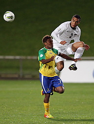 New Zealand's Winston Reid beats Solomon Islands' Henry Fa'arodo to the ball in a FIFA World Cup Qualifier Match, North Harbour Stadium, Auckland, New Zealand, Tuesday, September 11, 2012.  Credit:SNPA / David Rowland