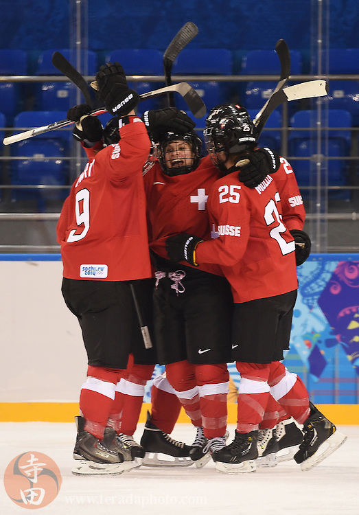 Feb 15, 2014; Sochi, RUSSIA; Switzerland forward Phoebe Stanz (88) celebrates with Switzerland forward Stefanie Marty (9) and Switzerland forward Alina Muller (25) after a goal was scored by Marty in a women's quarterfinals ice hockey game during the Sochi 2014 Olympic Winter Games at Shayba Arena.