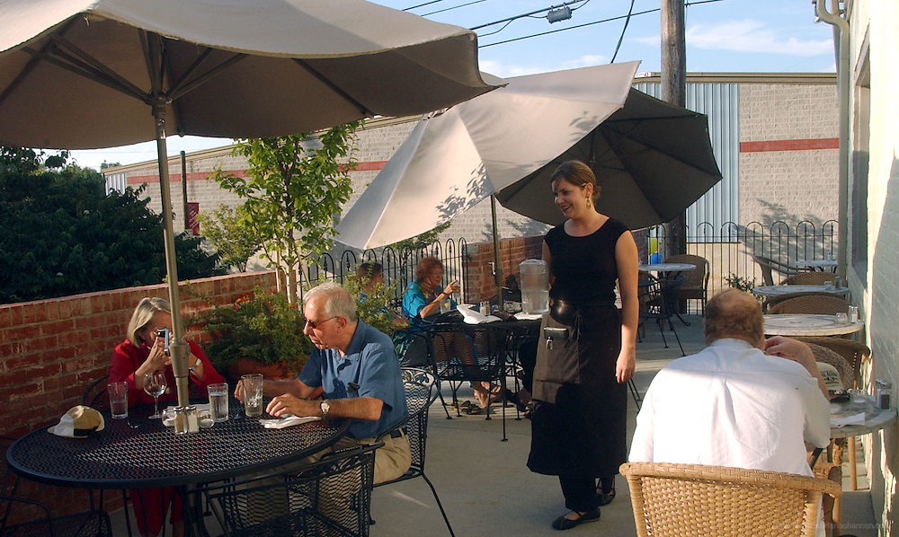 NORTH END CAFE:&amp;#xD;Outdoor dining at North End Cafe. Server is Tandee Ogburn.<br />