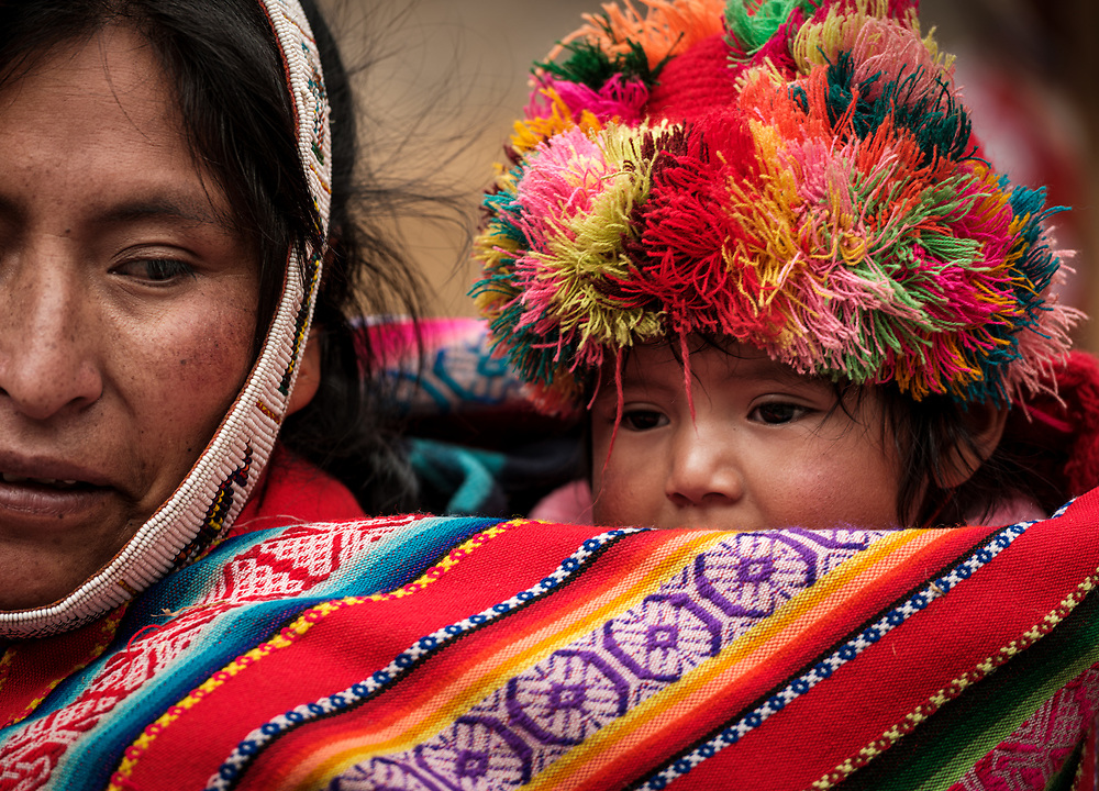 OLLANTAYTAMBO, PERU - CIRCA SEPTEMBER 2019:  Portrait of a baby and mother from the andean community of Willoq close to Ollantaytambo in the Sacred Valley of Peru.