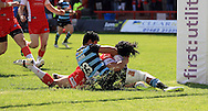 Ade Gardner (right) of Hull Kingston Rovers is held up on the try line by Denny Solomona of London Broncos during the First Utility Super League match at the KC Lightstream Stadium, Kingston upon Hull<br /> Picture by Richard Gould/Focus Images Ltd +44 7855 403186<br /> 25/05/2014
