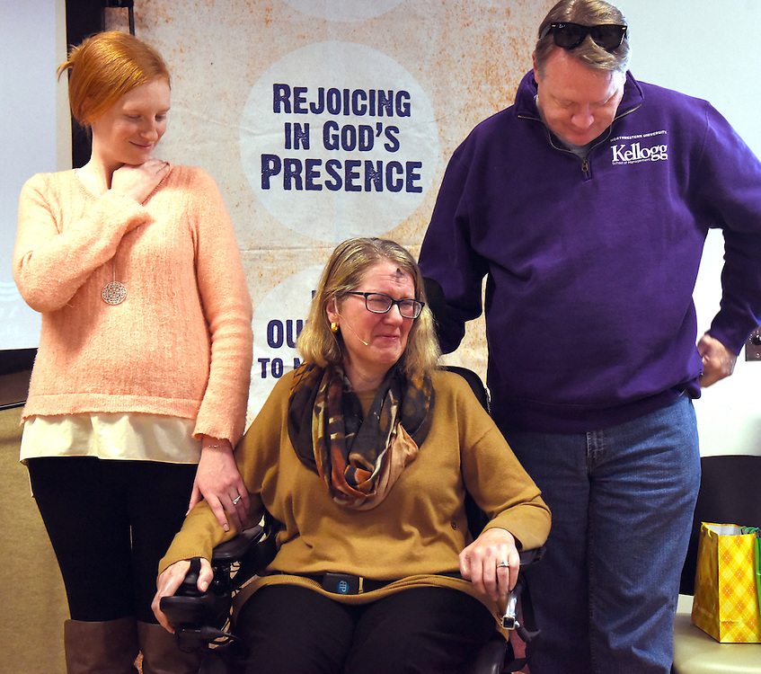 Mara Lavitt -- Special to the Hartford Courant<br /> February 14, 2016, Glastonbury<br /> Amyotrophic Lateral Sclerosis (ALS) forced Nancy Butler of Marlborough, right, to step down as pastor of the Riverfront Family Church in Glastonbury during the Sunday service. Nancy cries while listening to congregants' prayers for her. With her are her daughter Liza Arulampalam of Hartford, left, and her husband Greg Butler, right.