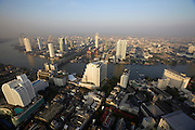Lebua at State Tower Hotel. Breathtaking sunrise view over Chao Phraya River and the skyscrapers at its banks.