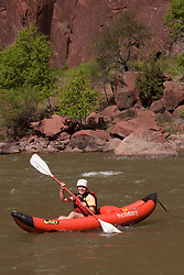 North America, United States, Colorado, Dinosaur National Monument, Green River (Gates of Lodore section), girl (age 10) in kayak. MR
