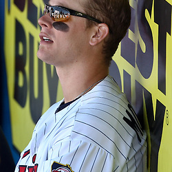 March 11, 2011; Fort Myers, FL, USA; Minnesota Twins first baseman Justin Morneau (33) sits on the bench after exiting a spring training exhibition game against the Boston Red Sox at Hammond Stadium.   Mandatory Credit: Derick E. Hingle