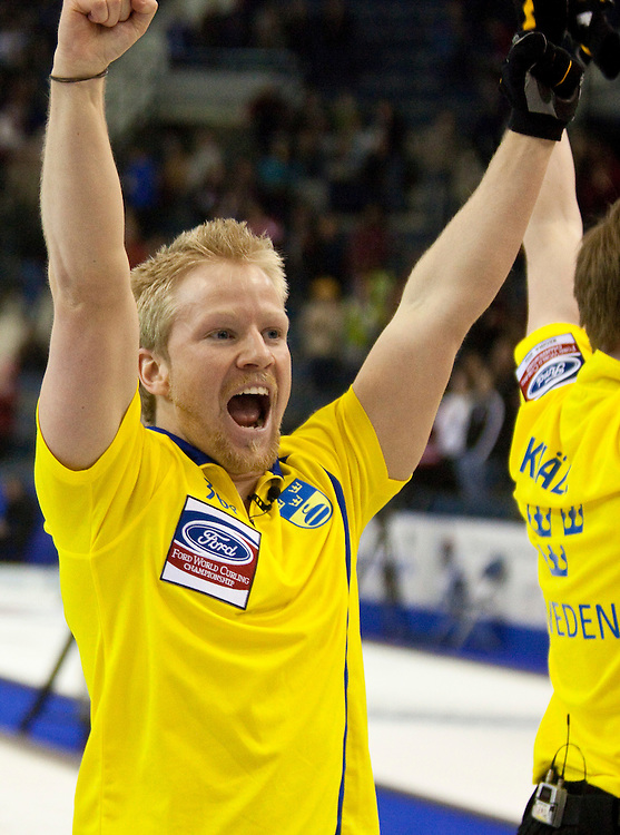 Swedish skip Niklas Edin, celebrates his  7-6 win over Norway in the bronze medal match at the Ford World Men's Curling Championships in Regina, Saskatchewan, April 10, 2011.<br /> AFP PHOTO/Geoff Robins