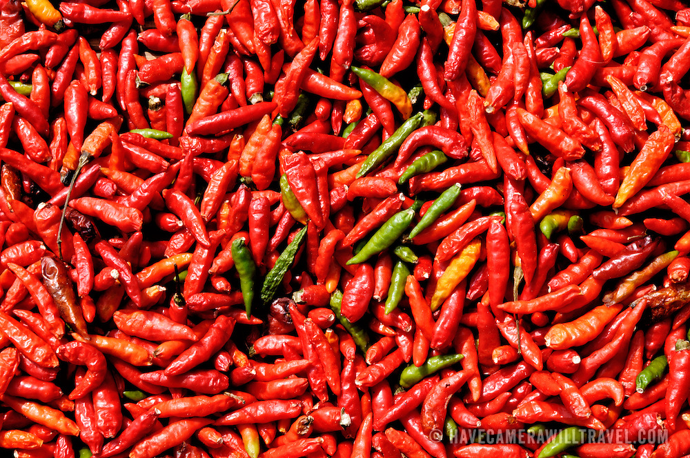 "Known to some as ""Lao shrimp"", red chilis are left out in the sun to dry. Luang Namtha province, Laos."