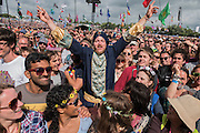 Fans in good spirits wile awaiting Madness at the Pyramid Stage - The 2016 Glastonbury Festival, Worthy Farm, Glastonbury.