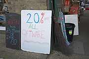 Hardware shop signs offering discounts 20% off all giftware