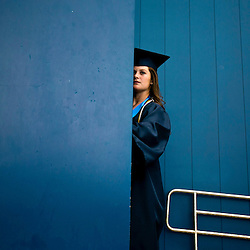 Senior Lauren Cordova pauses before she enters Taco Bell Arena to receive her diploma during Mountain View High School graduation Saturday May 23, 2015. Saturday May 23, 2015
