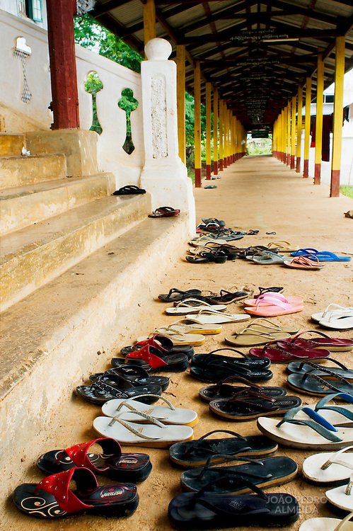 Shoes keep outside a Buddhist monastery, as they're not allowed inside