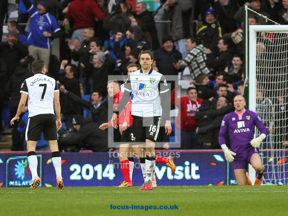 Picture by Tom Smith/Focus Images Ltd 07545141164<br /> 01/02/2014<br /> Johan Elmander (centre) of Norwich City can not believe it as Cardiff take the lead during the Barclays Premier League match at the Cardiff City Stadium, Cardiff.