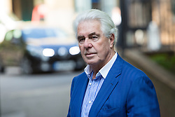 © Licensed to London News Pictures. 23/04/2014. London, UK. Publicist Max Clifford arrives at Southwark Crown Court in London on 23rd April 2014. The jury has retired to consider 11 charges of indecent assault against Mr Clifford.  Photo credit : Vickie Flores/LNP