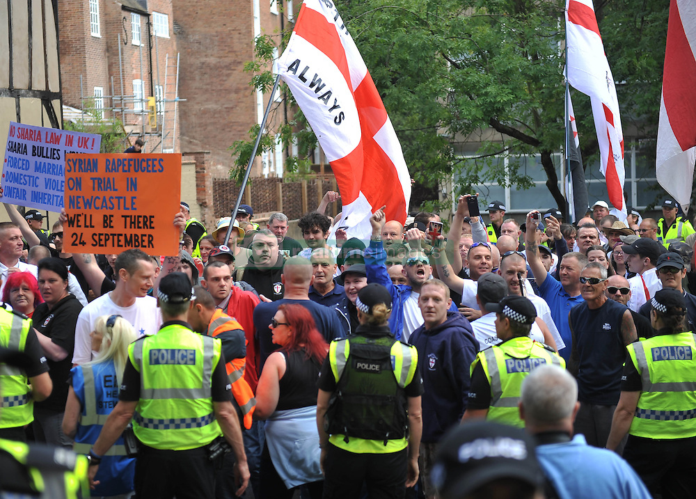 Protesters from the far-right group EDL (English Defence League) gather in the city of Nottingham. Nottinghamshire Police cordoned off city centre streets as the group made their way from Castle Wharf to the city centre.