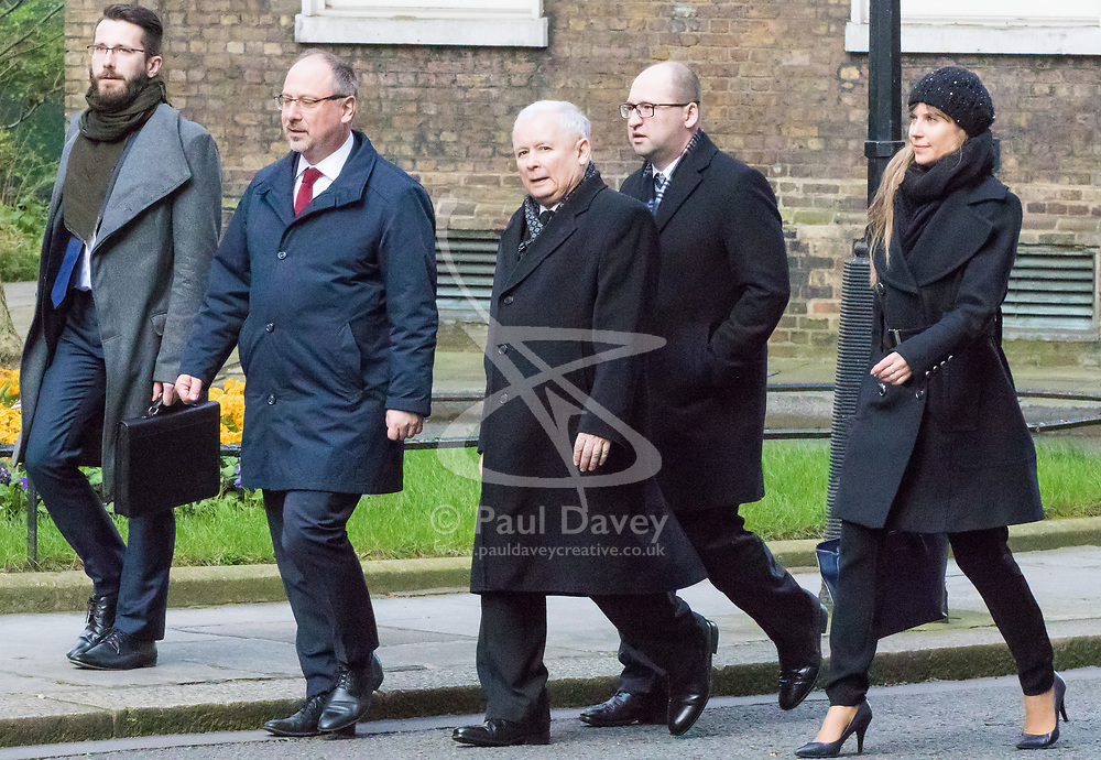 Downing Street, London, March 23rd 2017. Polish conservative Law and Justice Party leader and Eurosceptic Jaroslaw Kaczynski (C) arrives at 10 Downing Street for talks with British Prime Minister Theresa May.