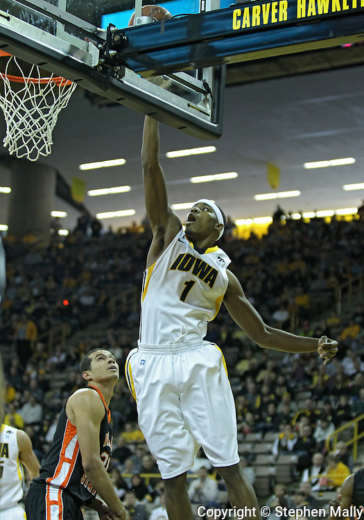 December 04 2010: Iowa Hawkeyes forward Melsahn Basabe (1) puts up a shot during the first half of their NCAA basketball game at Carver-Hawkeye Arena in Iowa City, Iowa on December 4, 2010. Iowa won 70-53.