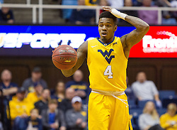 Dec 23, 2016; Morgantown, WV, USA; West Virginia Mountaineers guard Daxter Miles Jr. (4) calls out a play during the second half against the Northern Kentucky Norse at WVU Coliseum. Mandatory Credit: Ben Queen-USA TODAY Sports