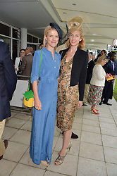 Left to right, ZOE WARREN and her sister in law SUSANNA WARREN at day 3 of the Qatar Glorious Goodwood Festival at Goodwood Racecourse, Chechester, West Sussex on 28th July 2016.