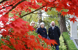 Prime Minister Theresa May (centre) walks at the St Symphorien Military Cemetery in Mons, Belgium, with Belgian Prime Minister Charles Michel and Liz Sweet, Director, External Relations, Western Europe Area, Commonwealth War Graves Commission.