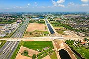 Nederland, Noord-Brabant, Den Bosch, 09-05-2013; werkzaamheden aan de Zuid-Willemsvaart. Kruising met spoorlijn, gezien richting Maas, links de A2, Het kanaal wordt verbreed, uitgegraven en omgelegd - zodat de binnenstad van Den Bosch vermeden kan worden. Het gaat niet allen om een omlegging, maar ook om een opwaardering zodat grote schepen van het kanaal gebruik kunnen blijven maken.<br /> New canal being build, new branch of Zuid-Willemsvaart.<br /> luchtfoto (toeslag op standard tarieven);<br /> aerial photo (additional fee required);<br /> copyright foto/photo Siebe Swart.