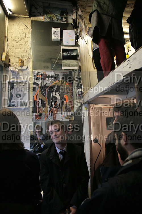 Bruno Travers and Henry Thomas, Viewing Club at Hats/Plus. 101b Kings Cross Rd. London. WC1. 3 April 2007.  -DO NOT ARCHIVE-© Copyright Photograph by Dafydd Jones. 248 Clapham Rd. London SW9 0PZ. Tel 0207 820 0771. www.dafjones.com.