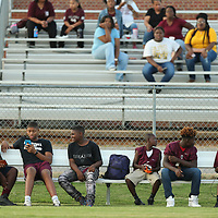 The Okolona team mangers and water boys take a break on the bench before they have to get to work during the game against Falkner on Friday.