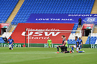 Football - 2019 / 2020 Sky Bet EFL Championship - Cardiff City vs. Leeds United<br /> <br /> Teams 'take the knee' before ko, at Cardiff City Stadium.<br /> <br /> COLORSPORT/WINSTON BYNORTH