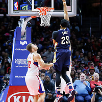 27 November 2015: New Orleans Pelicans forward Anthony Davis (23) goes for the jump shot over Los Angeles Clippers forward Blake Griffin (32) and Los Angeles Clippers guard J.J. Redick (4) during the Los Angeles Clippers 111-90 victory over the New Orleans Pelicans, at the Staples Center, Los Angeles, California, USA.