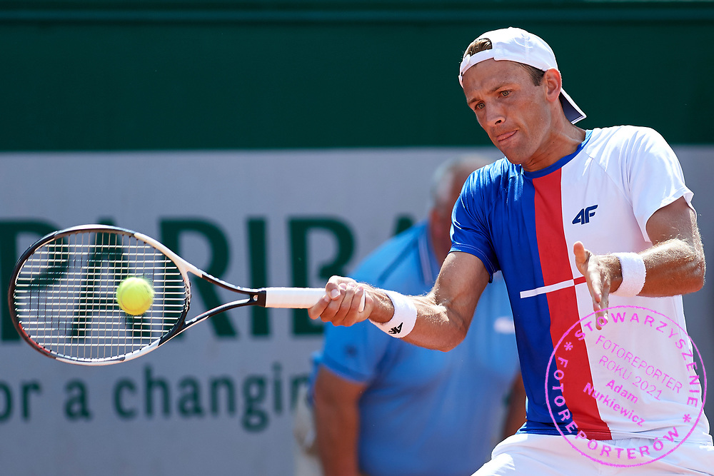 Paris, France - 2017 May 31: Lukasz Kubot from Poland plays a forehand while his men's double match first round during tennis Grand Slam tournament The French Open 2017 (also called Roland Garros) at Stade Roland Garros on May 31, 2017 in Paris, France.<br /> <br /> Mandatory credit:<br /> Photo by &copy; Adam Nurkiewicz<br /> <br /> Adam Nurkiewicz declares that he has no rights to the image of people at the photographs of his authorship.<br /> <br /> Picture also available in RAW (NEF) or TIFF format on special request.<br /> <br /> Any editorial, commercial or promotional use requires written permission from the author of image.