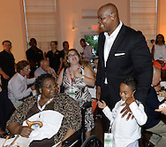 COOPERSTOWN, NY - JULY 26:  2014 Hall of Fame inductee Frank Thomas and son Frankie III visits with his mother during a private reception held at Templeton Hall in Cooperstown, New York on July 26 2014.