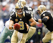 New Orleans Saints quarterback Drew Brees (9) looks to hand the ball off to a teammate against the Dallas Cowboys at Cowboys Stadium in Arlington, Texas, on December 23, 2012.  (Stan Olszewski/The Dallas Morning News)