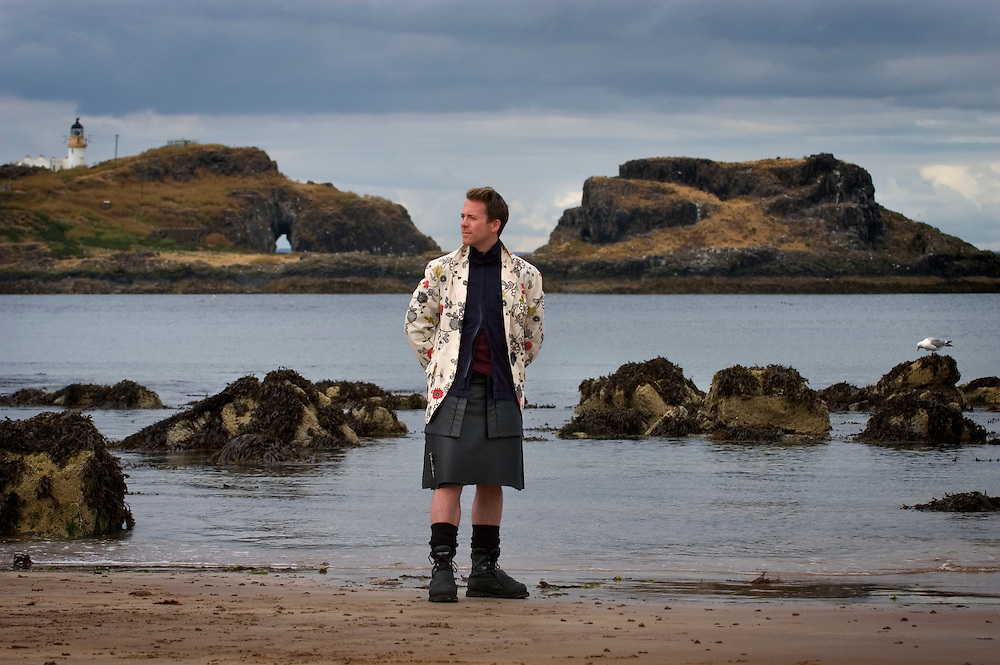 Nicol Nicolson from Visit Scotland, wearing a black leather kilt from 21st Century Kilts. Photographed at Yellowcraig Beach East of Edinburgh, Scotland, UK.