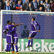 Cyle Larin, Orlando, celebrates with team mates after heading the winning goal as goalkeeper Josh Saunders, NYCFC, failed to cut out a cross, during the New York City FC Vs Orlando City, MSL regular season football match at Yankee Stadium, The Bronx, New York,  USA. 18th March 2016. Photo Tim Clayton